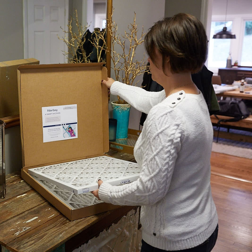 woman unboxing air filter subscription