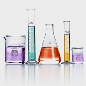 science beakers filled with different colored liquids