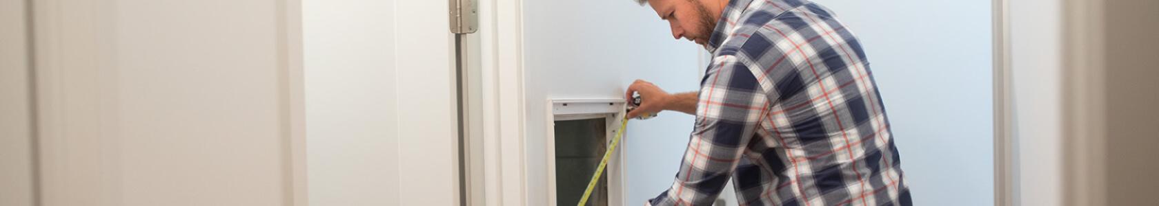 man measures vent for filter size
