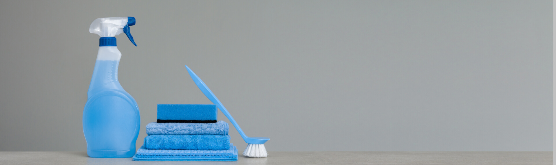 Cleaning items against a gray background